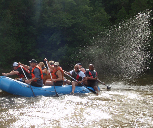 Corporate team building rafting adventures near Toronto Waterloo London n the Grand River