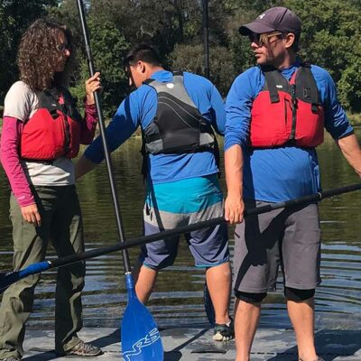 Paddling an eight person Stand up paddleboard