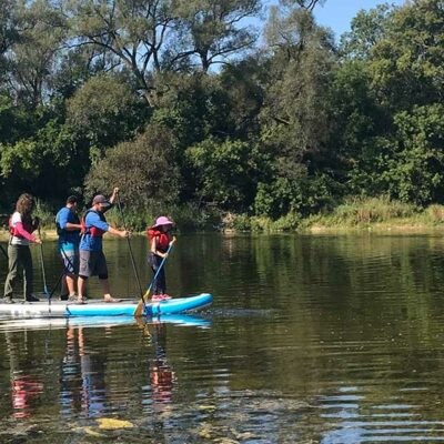 Paddling the eight person stand up paddleboard Grand River Rafting