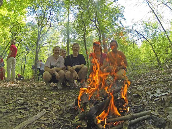 Students learning how to build fire